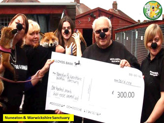 Nuneaton and Warwickshire Sanctuary receive cheque from Wetnose