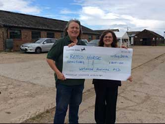Remus Horse Sanctuary receive cheque from Wetnose